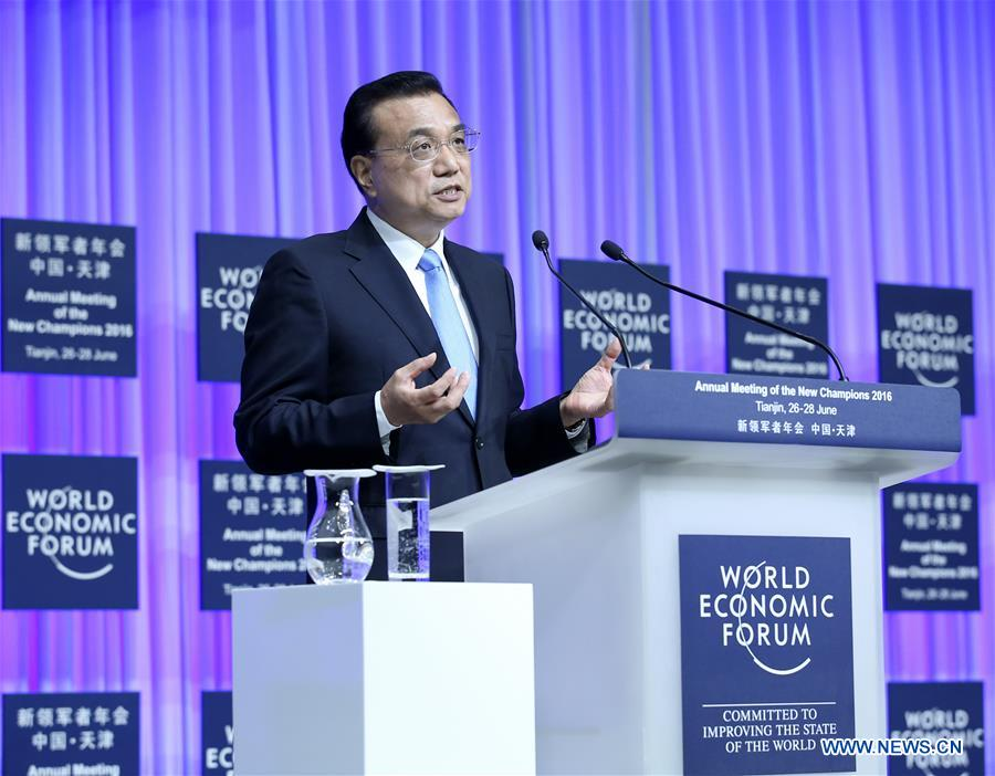 Chinese Premier Li Keqiang addresses the opening ceremony of the Annual Meeting of the New Champions 2016, or Summer Davos Forum, in Tianjin, north China, June 27, 2016.