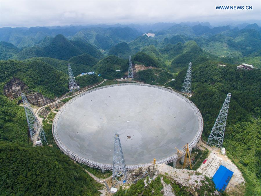 The aerial photo taken on July 3, 2016 shows the Five-hundred-meter Aperture Spherical Telescope (FAST) in Pingtang County, southwest China's Guizhou Province.