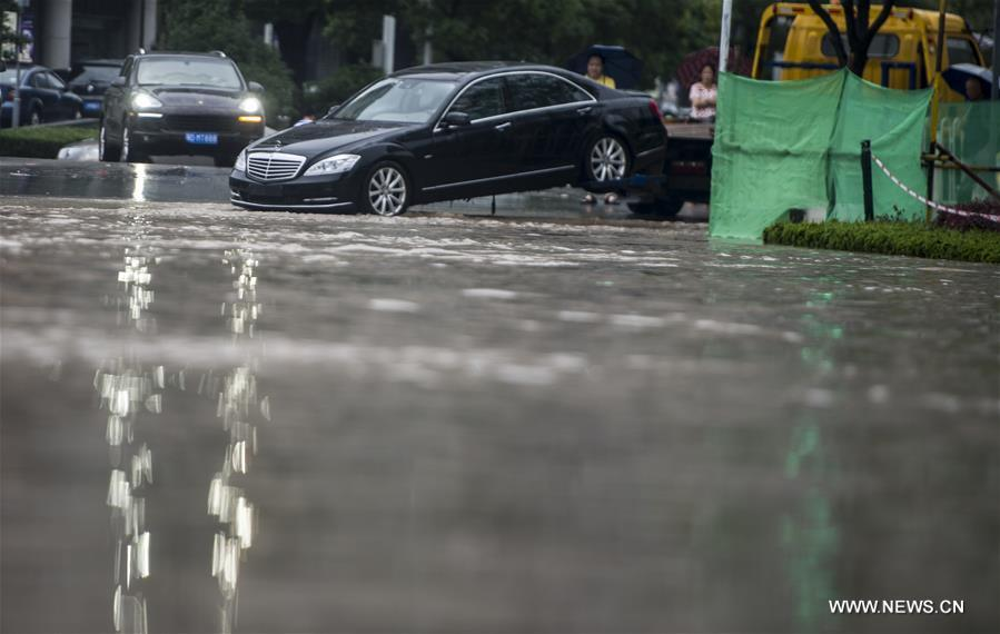 The downpour caused severe waterlogging as rivers, lakes and reservoirs of the city have swollen, leading to closure of a tunnel across the Yangtze as well as some subway stations and underground passages, according to local traffic authorities.