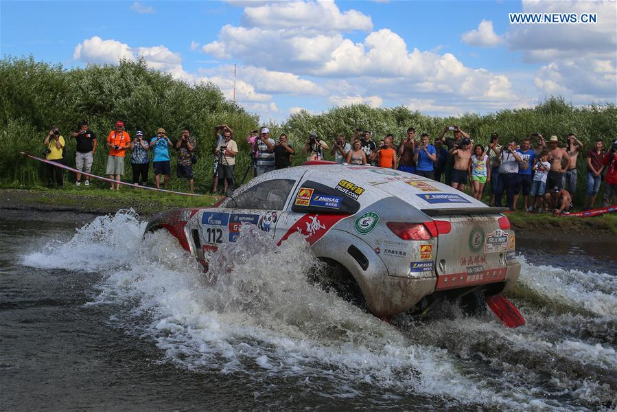 Liu Kun and Pan Hongyu of Panda Team of China compete during the third stage of the Moscow-Beijing Silk Road rally 2016 in Ufa, Russia on July 11, 2016.