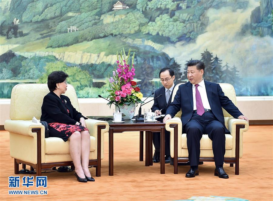 (时政)习近平会见世界卫生组织总干事陈冯富珍