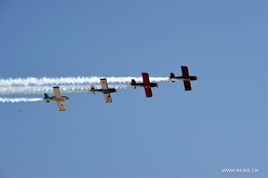 Planes take part in the aerobatics performance at an international general aviation convention in Zhangye City, northwest China's Gansu Province, Aug. 26, 2016.