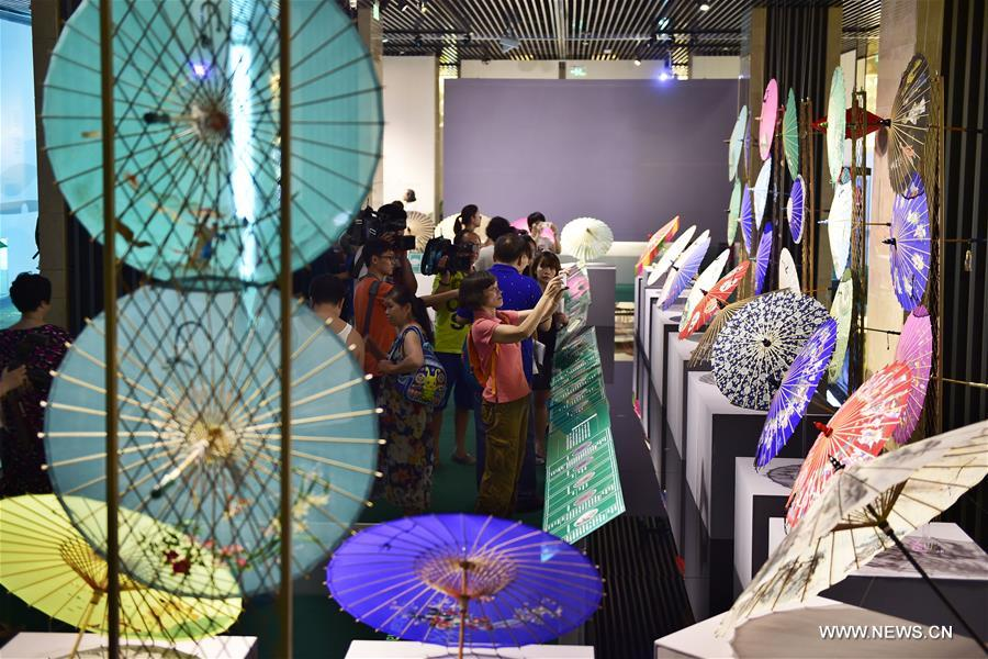 Traditional materials and tools used for making silk umbrellas are displayed during a West Lake silk umbrella show in Hangzhou, capital of east China's Zhejiang Province, Aug. 26, 2016.