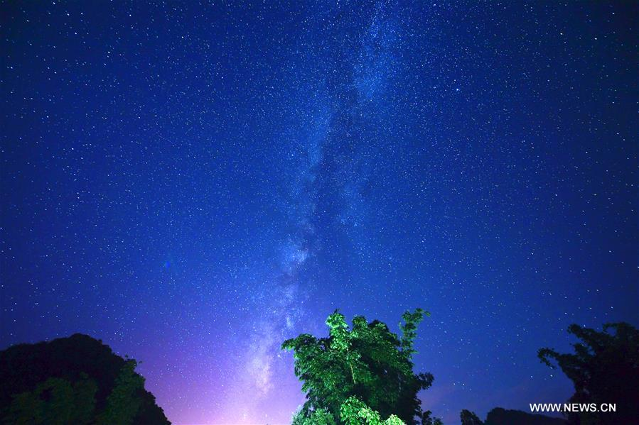 Photo taken on Aug. 25, 2016 shows starry sky in Jiulong Waterfall Scenic Spot of Luoping, southwest China's Yunnan Province.