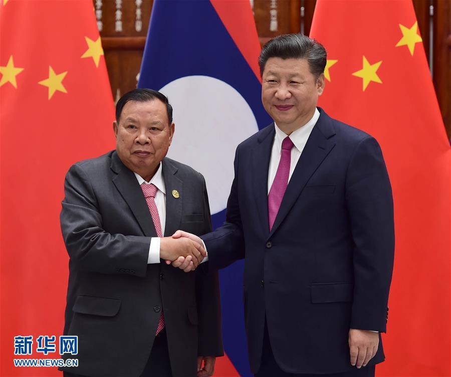 习主席老婆图片_习近平会见老挝国家主席本扬--图片频道--人民网