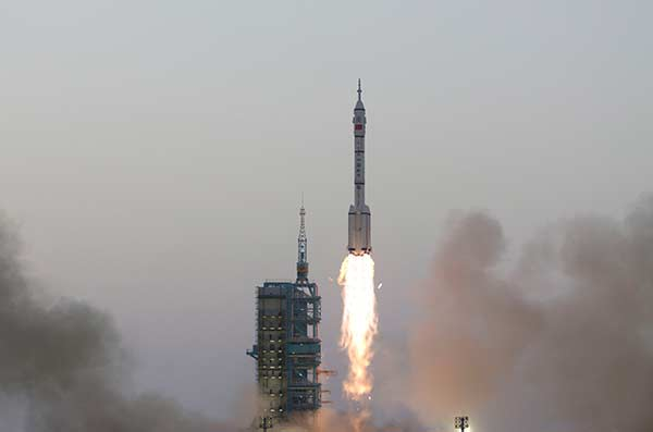 China launches manned spacecraft