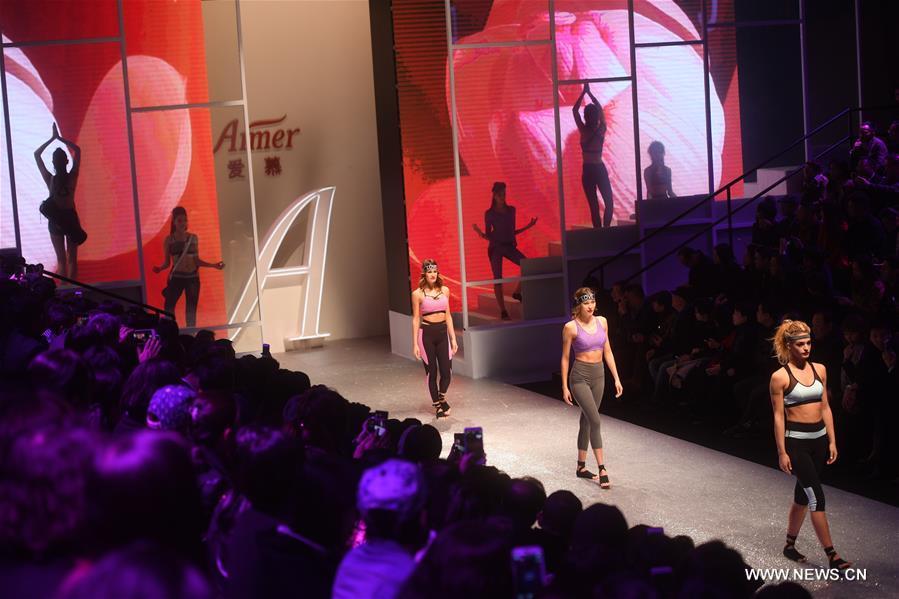 A model shows a creation of Aimer during the China Fashion Week in Beijing, capital of China, Oct. 30, 2016. (Xinhua/Jin Liangkuai)
