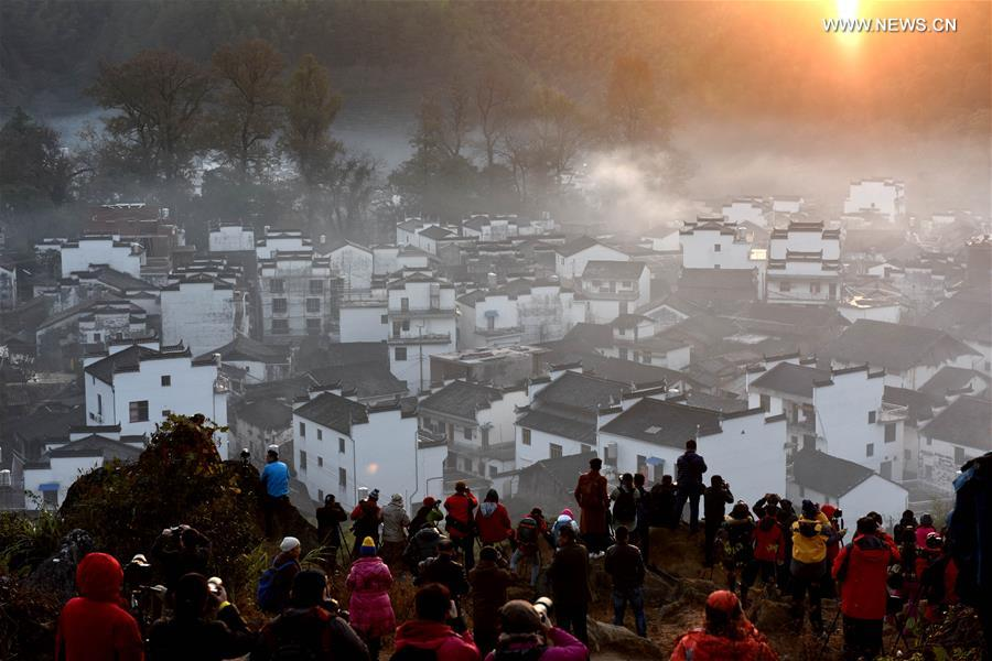 Early morning fog scenery of Shicheng Village in east China's Wuyuan
