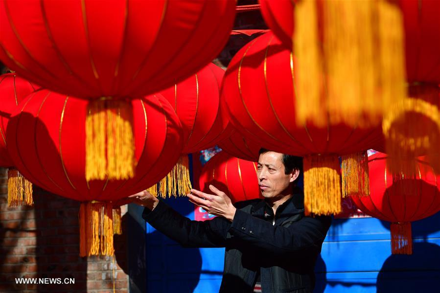 Red lanterns made for Spring Festival decorations in N China's village