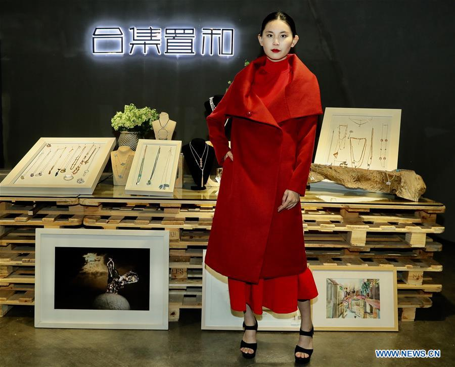 A model presents a creation of designer Zhang Yichao at an inauguration ceremony of an incubator of fashion and innovative talents in Hangzhou, capital of east China's Zhejiang Province, March 17, 2017. The talents incubator is jointly developed by fashion college of Zhejiang Sci-tech University, School of Fashion of Wuhan Textile University and a customization platform. (Xinhua/Chen Jianli)