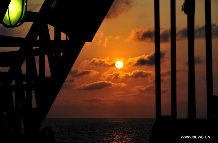 Enjoying sunset scenery of South China Sea on U.S. drilling ship in expedition