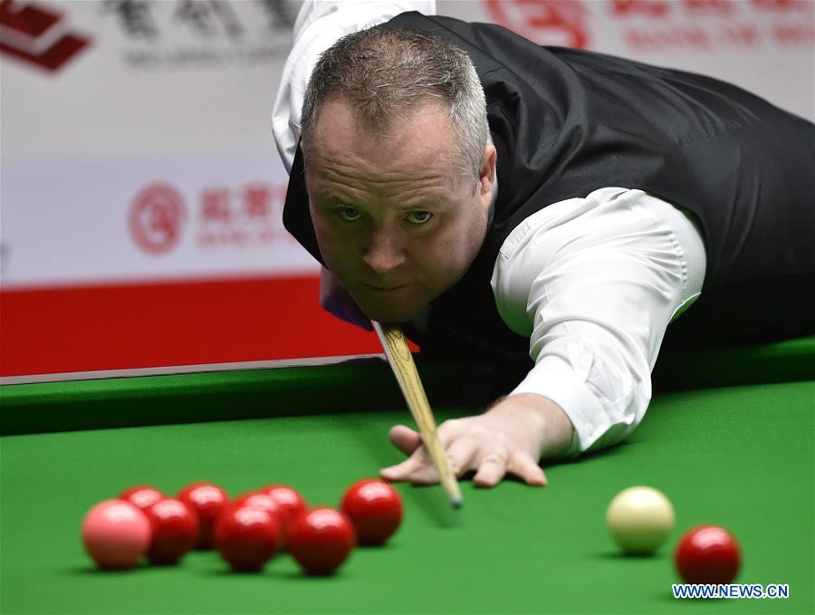 John Higgins of Scotland competes during the second round match of 2017 World Snooker China Open Tournament against Mark Davis of England in Beijing, capital of China, March 29, 2017. John Higgins won 5-2.
