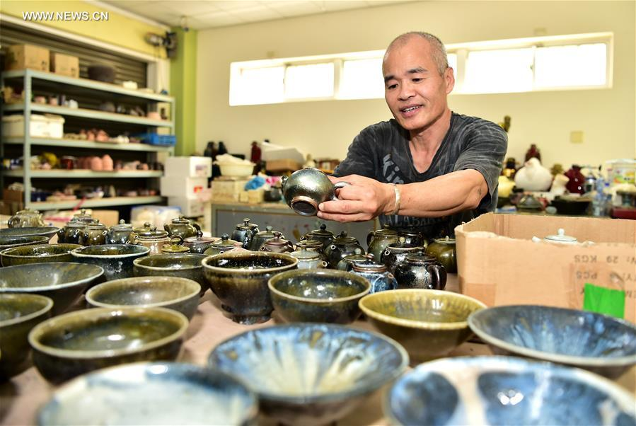 Red clay potteries with peculiar style made in China's Taiwan