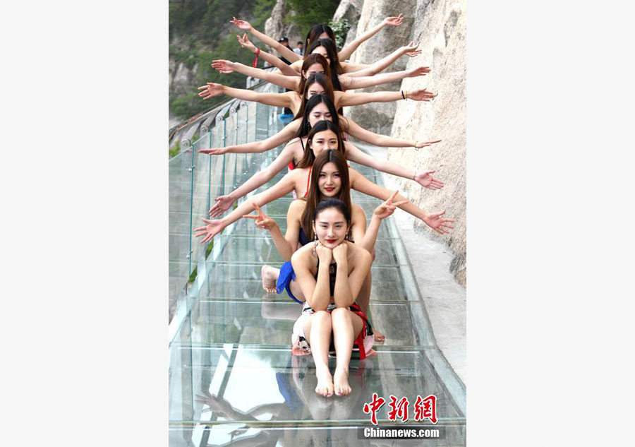 Models catwalk in bikini on 1,000-meter-high mountainside