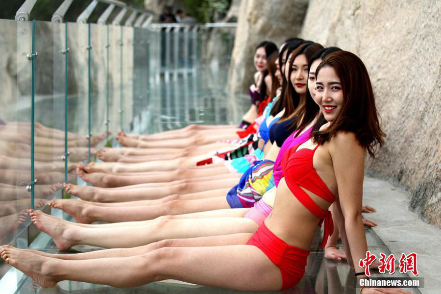 Models catwalk in bikini on 1,000-meter-high mountainside