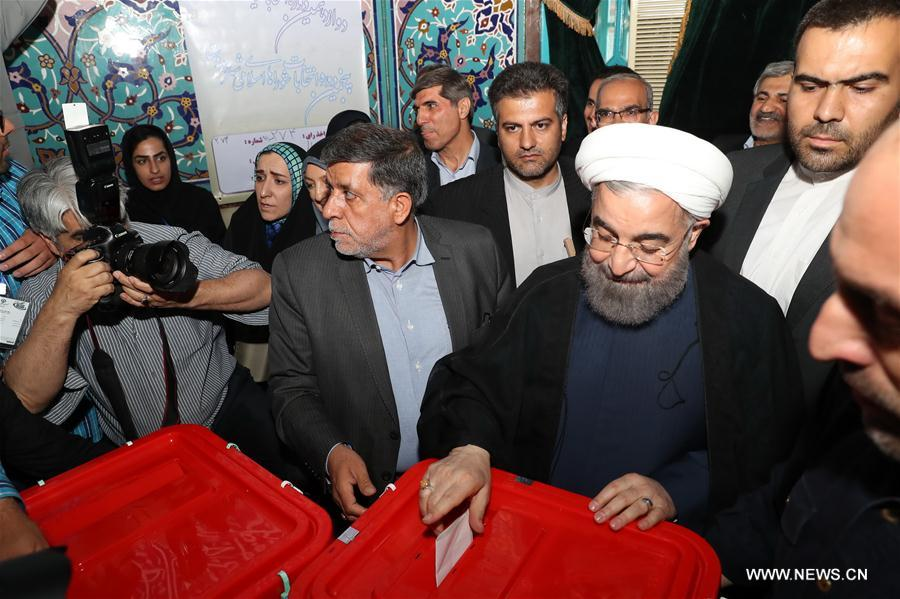 Iranians vote for president in high turnout