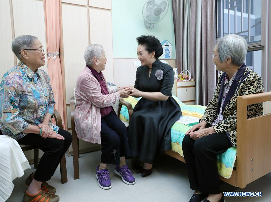 Wife of Chinese president visits elderly center in Hong Kong