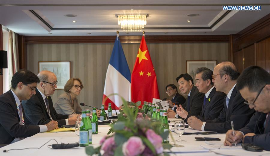 China ready to work with France to support economic globalization, reform global governance -- FM
