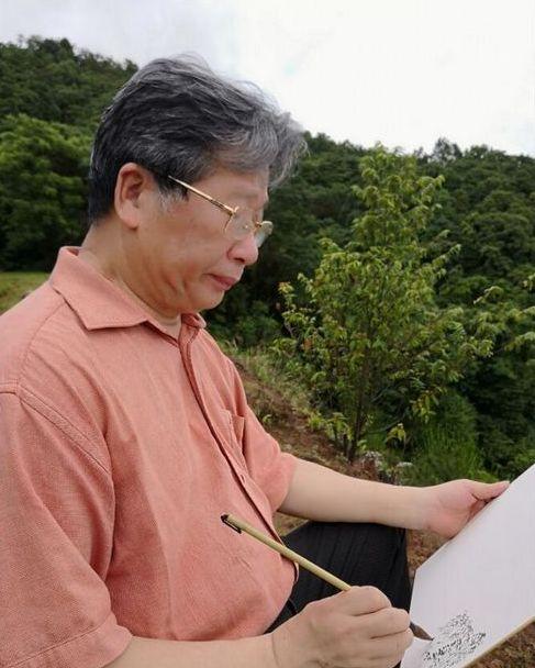 中国美术家协会副主席、广东省文联主席许钦松在惠州写生