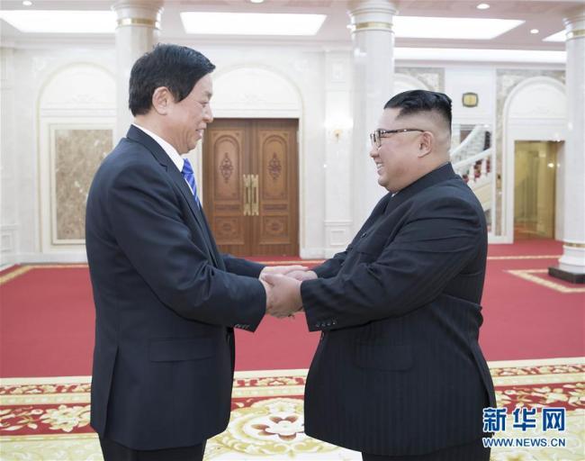 China's top legislator Li Zhanshu met with Kim Jong Un, top leader of the Democratic People's Republic of Korea (DPRK) in Pyongyang on Sunday. [Photo: Xinhua]