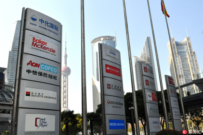 Billboards of foreign companies are showed in Shanghai, March 4, 2018. [Photo: IC]