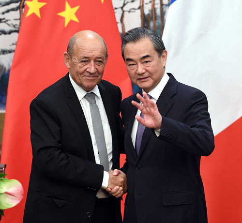 Chinese State Councilor and Foreign Minister Wang Yi meets with French Foreign Minister Jean-Yves Le Drian in Beijing on Thursday, September 13, 2018. [Photo: fmprc.gov.cn]