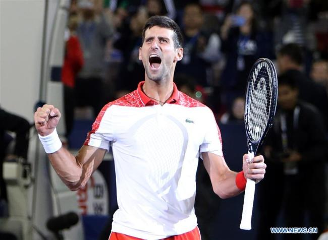 Novak Djokovic of Serbia celebrates after winning the men's singles final match against Borna Coric of Croatia at 2018 ATP Shanghai Masters tennis tournament in Shanghai, east China, Oct. 14, 2018. Novak Djokovic won 2-0 in the final and claimed the title of the event. [Photo: Xinhua/Fan Jun]