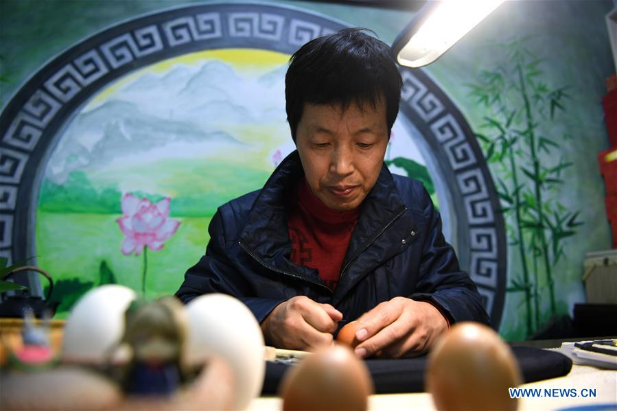 In pics: Chinese train driver devoted to egg carving for 24 years