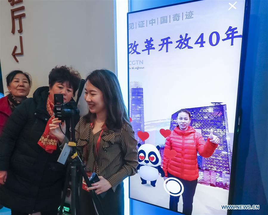 People visit major exhibition marking China's reform and opening-up