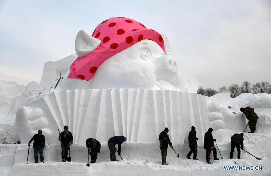 "In pics: snow sculpture with ""happy pigs"" theme in Harbin, NE China"