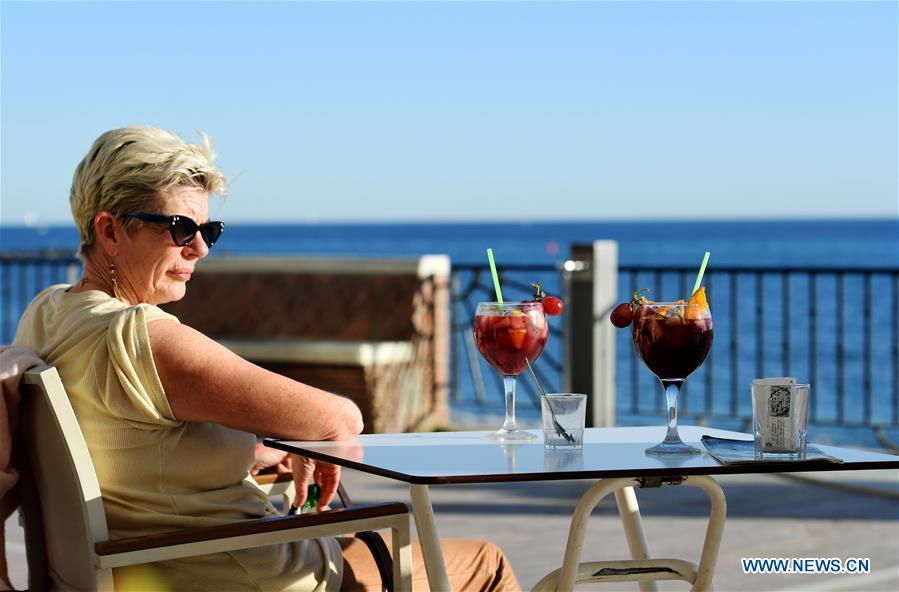 Warm weather in Spain's Marbella attracts tourists during winter