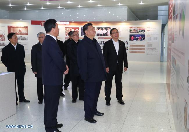 Xi Jinping, general secretary of the Central Committee of the Communist Party of China, Chinese president and chairman of the Central Military Commission, visits an exhibition on Nankai University's 100-year history at the university in Tianjin, Jan. 17, 2019. [Photo: Xinhua/Xie Huanchi]