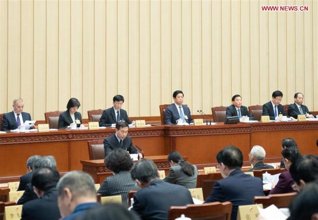 Li Zhanshu, chairman of the National People's Congress (NPC) Standing Committee, presides over the first plenary meeting of the eighth session of the 13th NPC Standing Committee in Beijing, capital of China, Jan. 29, 2019. [Photo: Xinhua/Shen Hong]