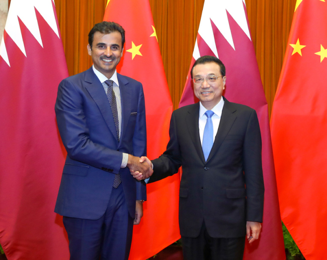 Chinese Premier Li Keqiang meets with visiting Qatari emir Sheikh Tamim Bin Hamad al-Thani at the Great Hall of the People in Beijing on January 31, 2019. [Photo: Gov.cn]