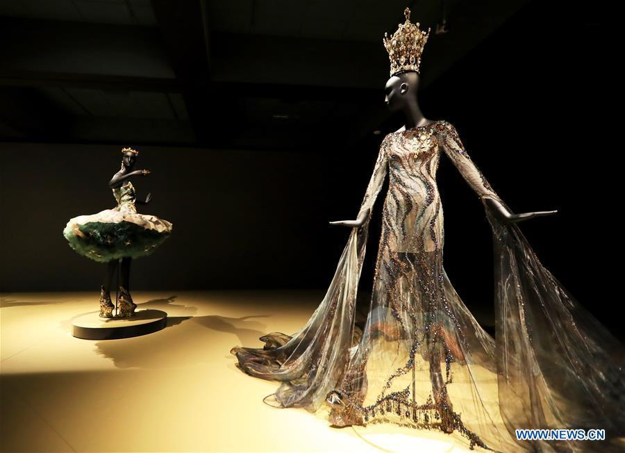 Photo taken on March 7, 2019 shows creations of Chinese couturier Guo Pei at her \