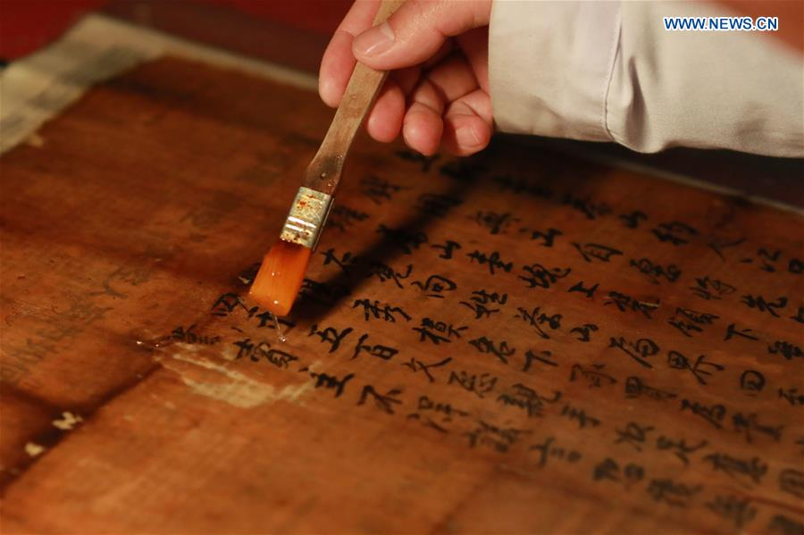 Pic story: museum curator dedicated to protecting ancient documents in Guizhou