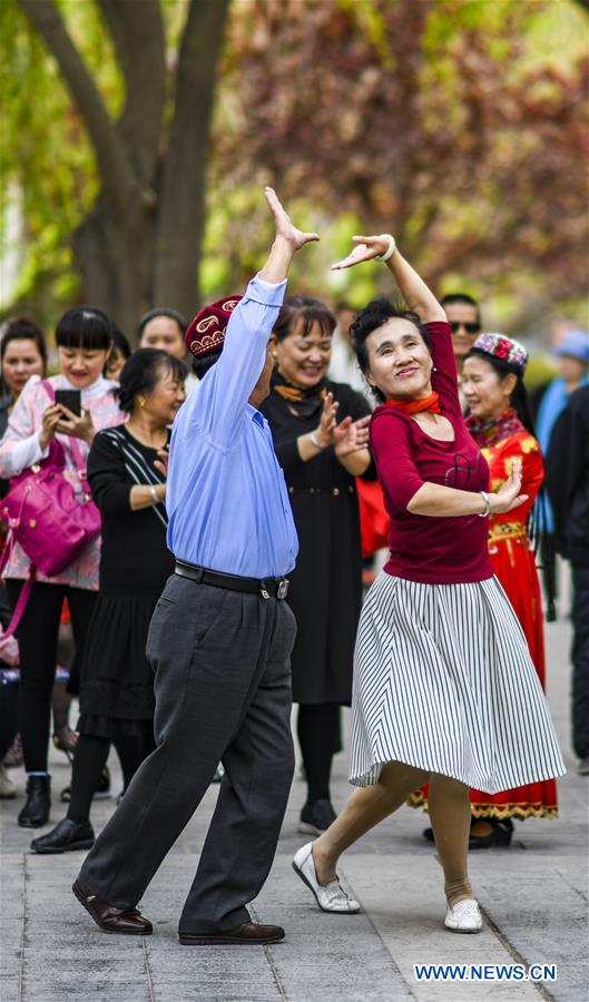 People dance at square in NW China's Xinjiang