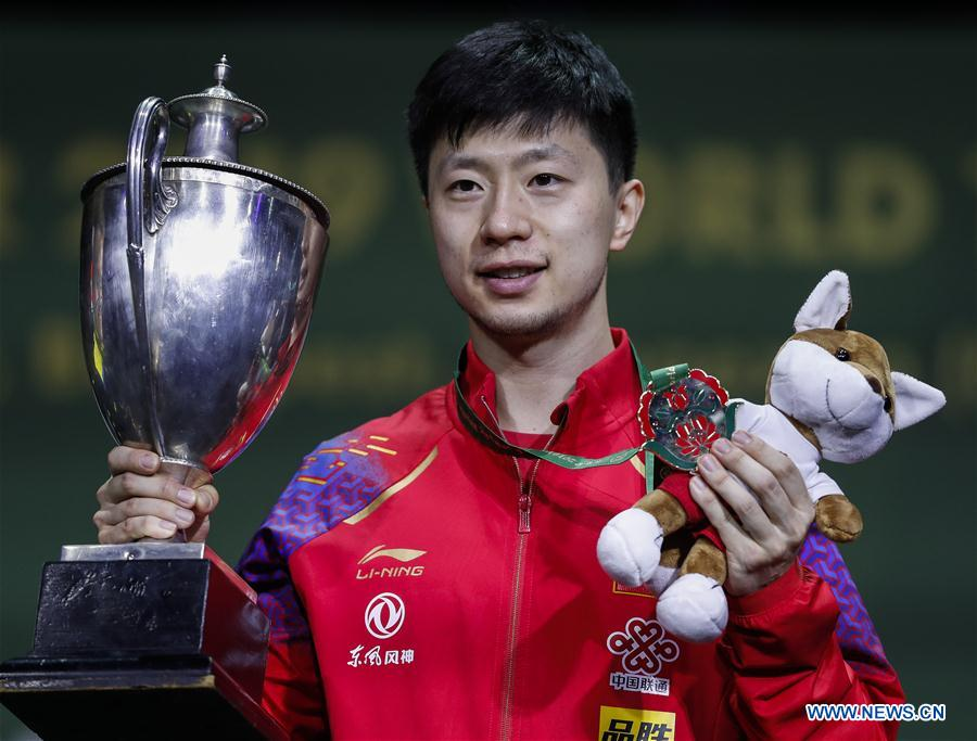 Ma Long claims third crown, a first in half a century