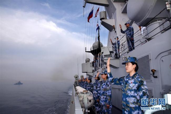 Chinese naval soldiers wave goodbye to their Russian counterparts on the sea off Qingdao, east China's Shandong Province, on May 4, 2019. [Photo: Xinhua]