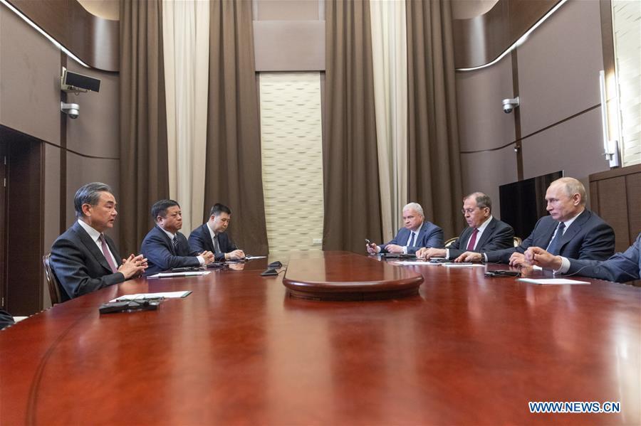 RUSSIA-SOCHI-PUTIN-CHINA-WANG YI-MEETING