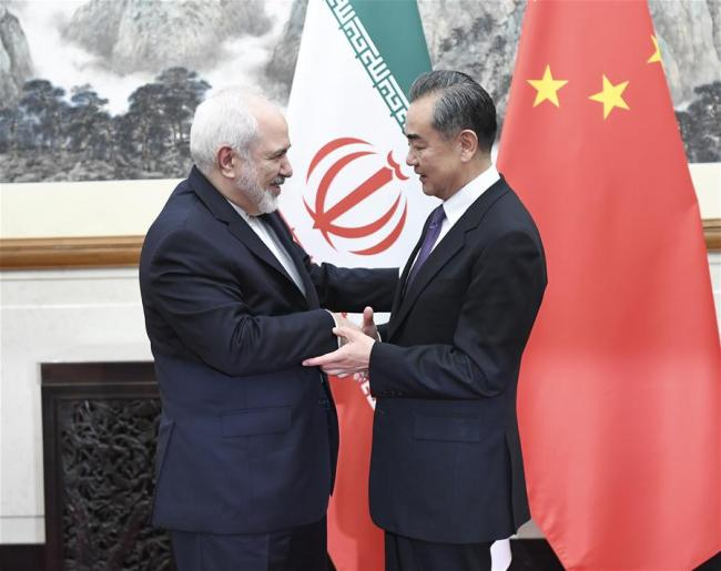 Chinese State Councilor and Foreign Minister Wang Yi (R) meets with visiting Iranian Foreign Minister Mohammad Javad Zarif in Beijing, capital of China, May 17, 2019. [Photo: Xinhua/Yin Bogu]