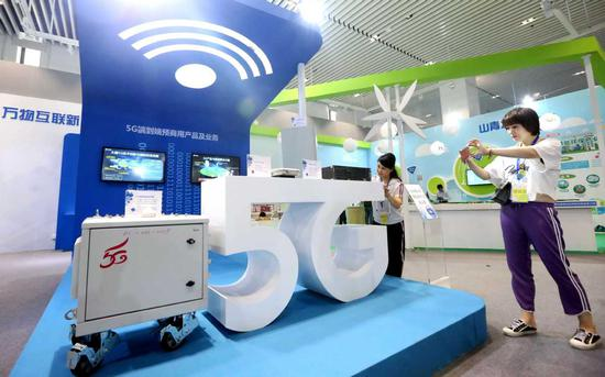 A booth showcasing 5G technology is pictured at an industry expo in Beijing. [Photo by Chen Xiaogen/China Daily]
